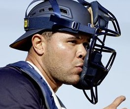 Minnesota Twins catcher Josmil Pinto loses his face mask as he throws the ball to first base during a spring training baseball workout, Tuesday, Feb. 19, 2013, in Fort Myers, Fla. (AP Photo/David Goldman)