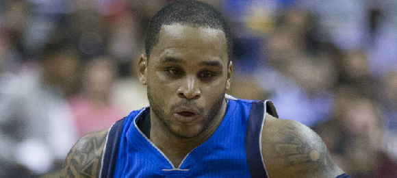 By File:Jameer Nelson Mavs.jpg: Keith Allison derivative work: Chrishmt0423 [CC BY-SA 2.0 (http://creativecommons.org/licenses/by-sa/2.0)], via Wikimedia Commons