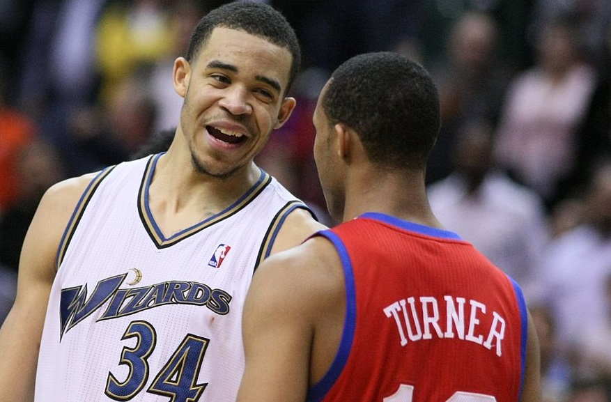 By Keith Allison. CCSA 2.0. Flickr via WikiCommons (https://upload.wikimedia.org/wikipedia/commons/a/a2/JaVale_McGee_laughs_at_or_with_Evan_Turner.jpg)
