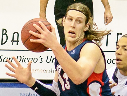 By SD Dirk. CCSA2.0. Flickr via Wikicommons (https://commons.wikimedia.org/wiki/File:Kelly_Olynyk_v_USD_Toreros.jpg)